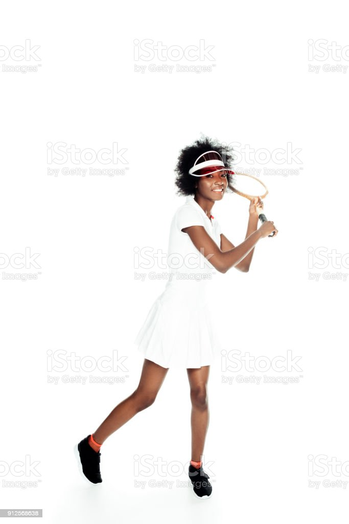 happy young female tennis player preparing to serve isolated on white stock photo