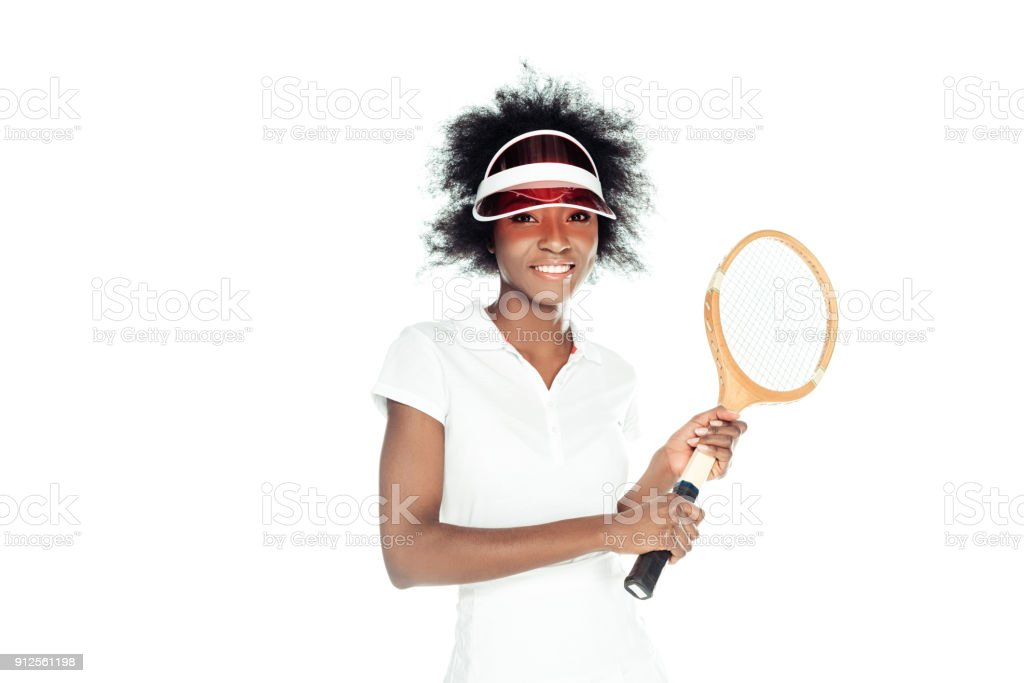 happy young female tennis player with racket isolated on white stock photo