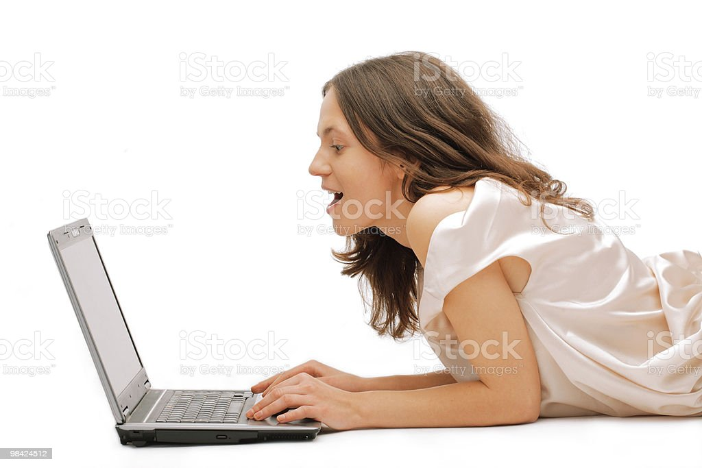 Happy young female using a laptop royalty-free stock photo