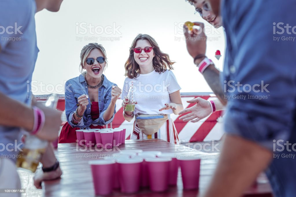 Happy young females making fists from gladness stock photo