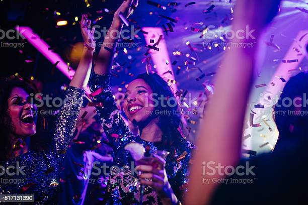Happy young friends partying with drinks and confetti in nightclub picture id517131390?b=1&k=6&m=517131390&s=612x612&h=dyfgnlgcodhd prbf73br2i9uad2sh2qptdjfvcmhpa=