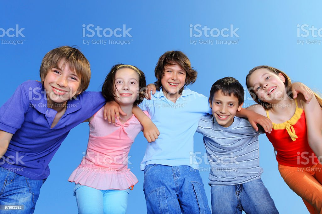 Happy young friends standing together outdoor. royalty-free stock photo