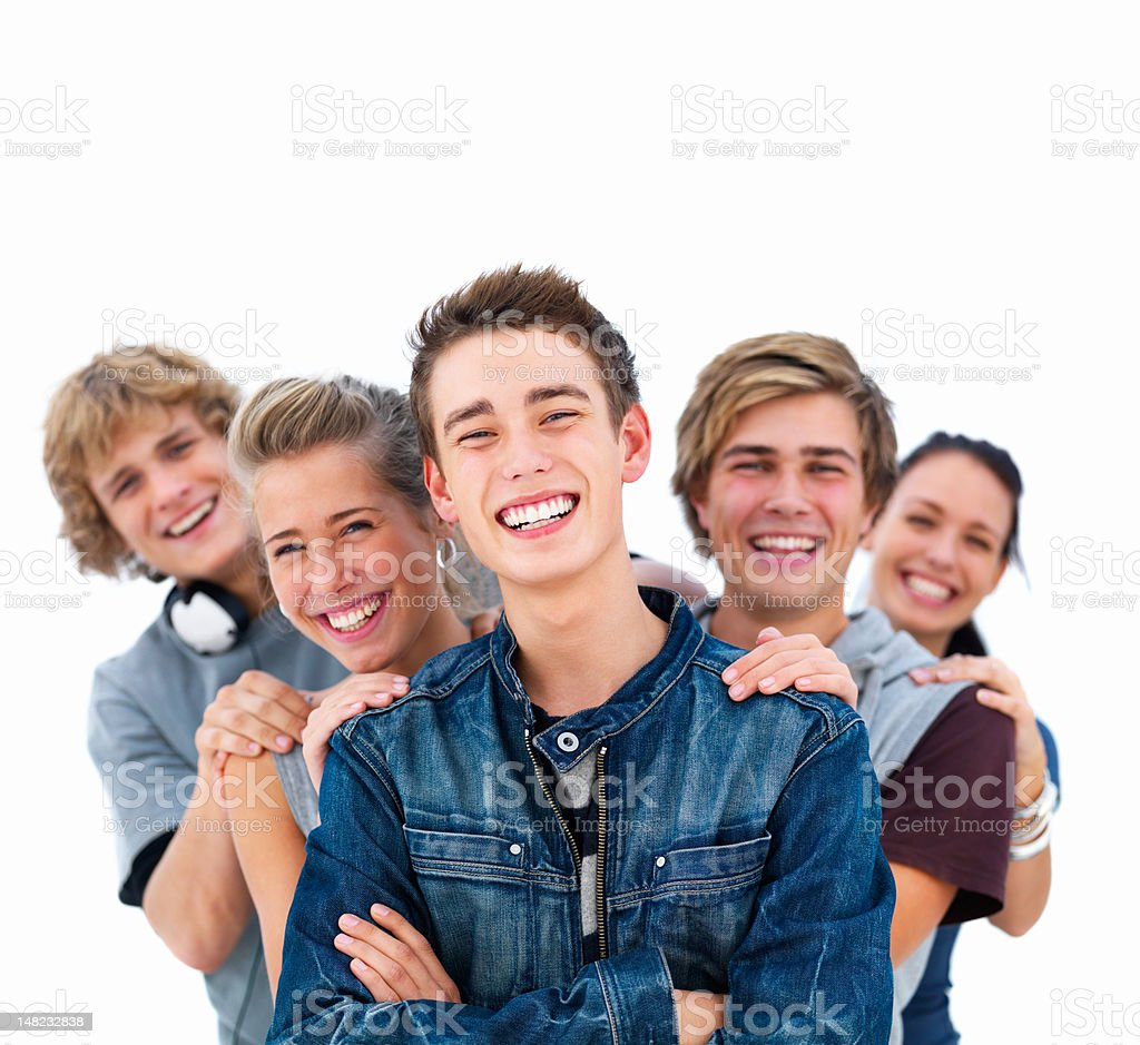 Happy young friends standing together royalty-free stock photo