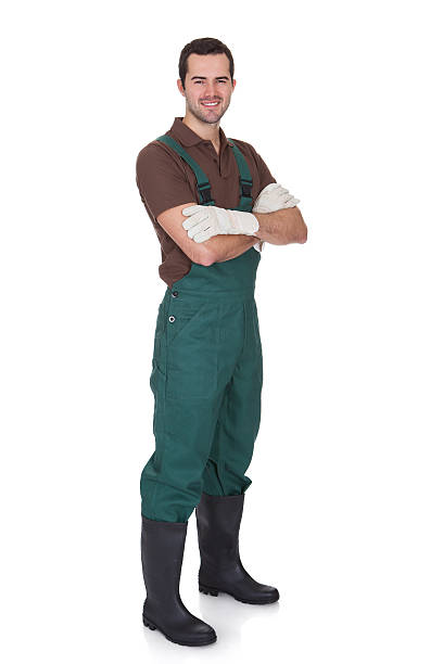 Happy young gardener in dungarees stock photo