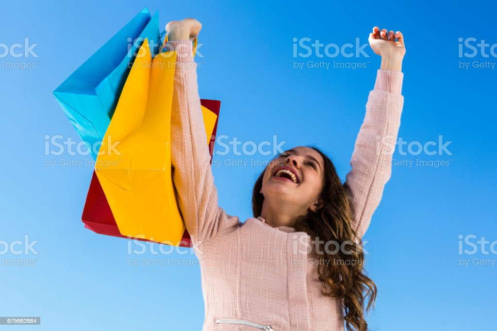 Happy young girl after shopping royalty-free stock photo