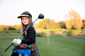A Happy Young Girl at the Golf Course