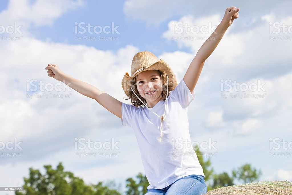 Happy young girl celebrating royalty-free stock photo