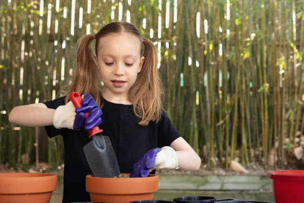 Happy Young Girl Gardening stock photo