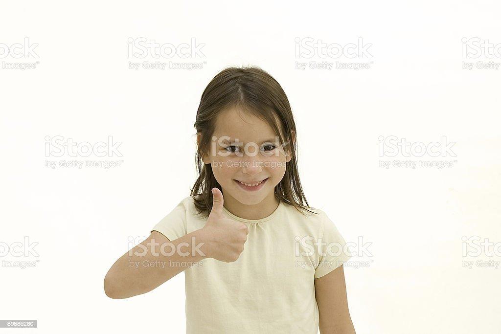 Glückliche junge Mädchen geben ok Lizenzfreies stock-foto
