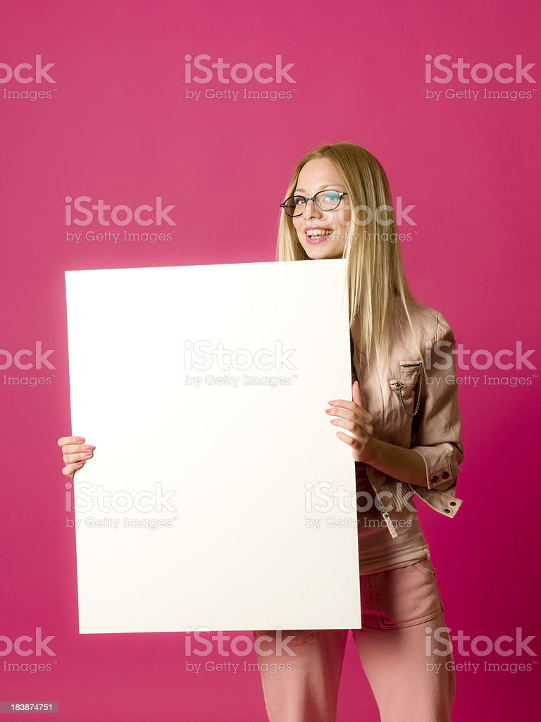 Happy young girl holding a white billboard royalty-free stock photo