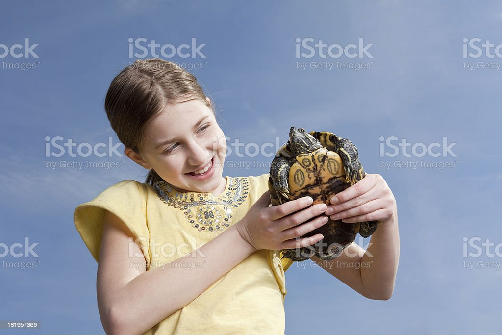 Happy Young Girl Holding Turtle royalty-free stock photo