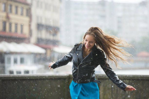 Happy young girl in the rain