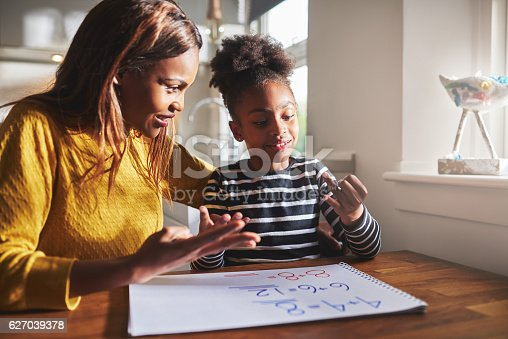 istock Happy young girl learning to calculate 627039378