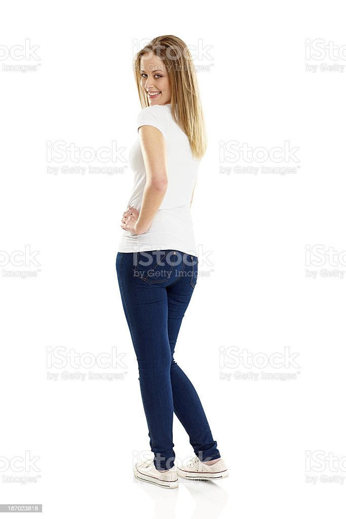 Happy young girl looking back at you royalty-free stock photo