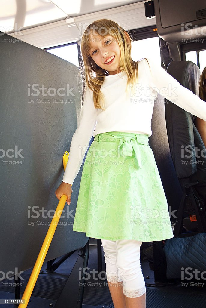 Happy Young Girl on a School Bus royalty-free stock photo