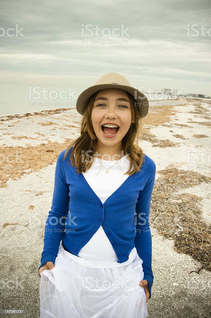Happy young girl on the beach. royalty-free stock photo