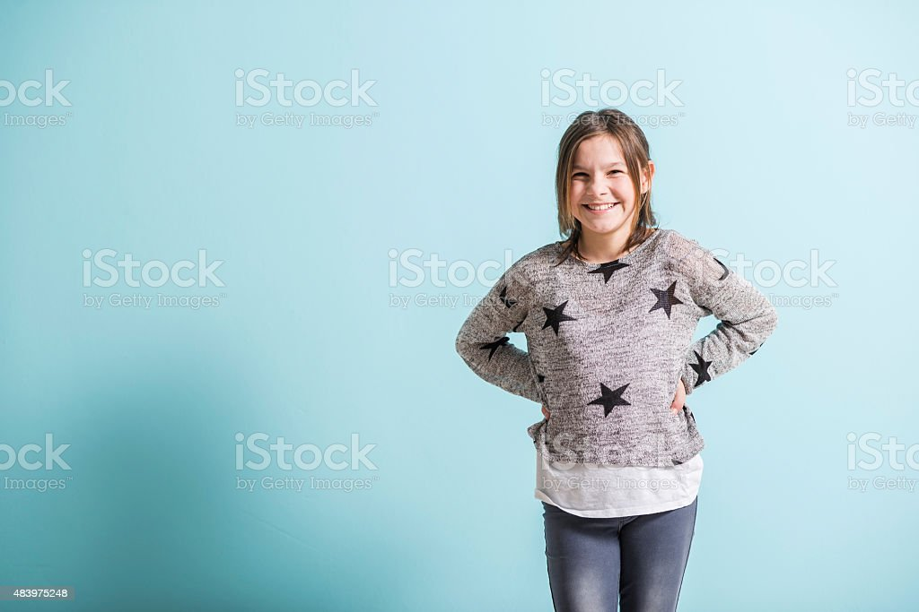 Happy young girl smiling happily stock photo