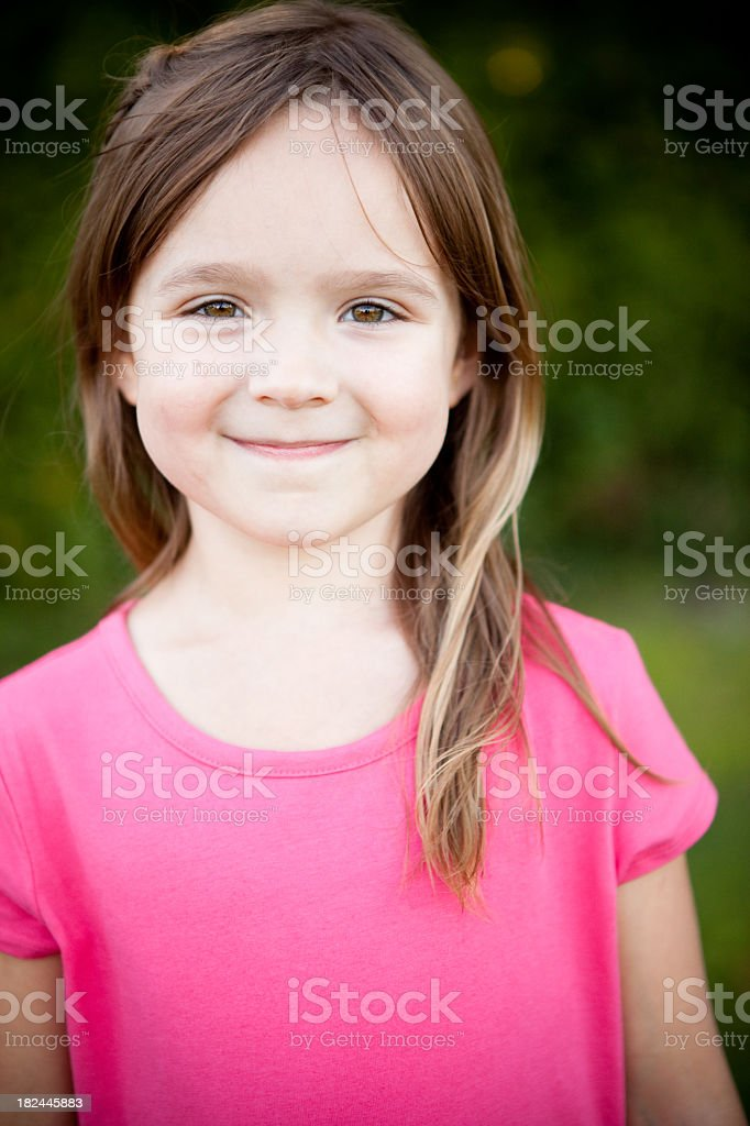 Happy Young Girl Smiling Outside stock photo