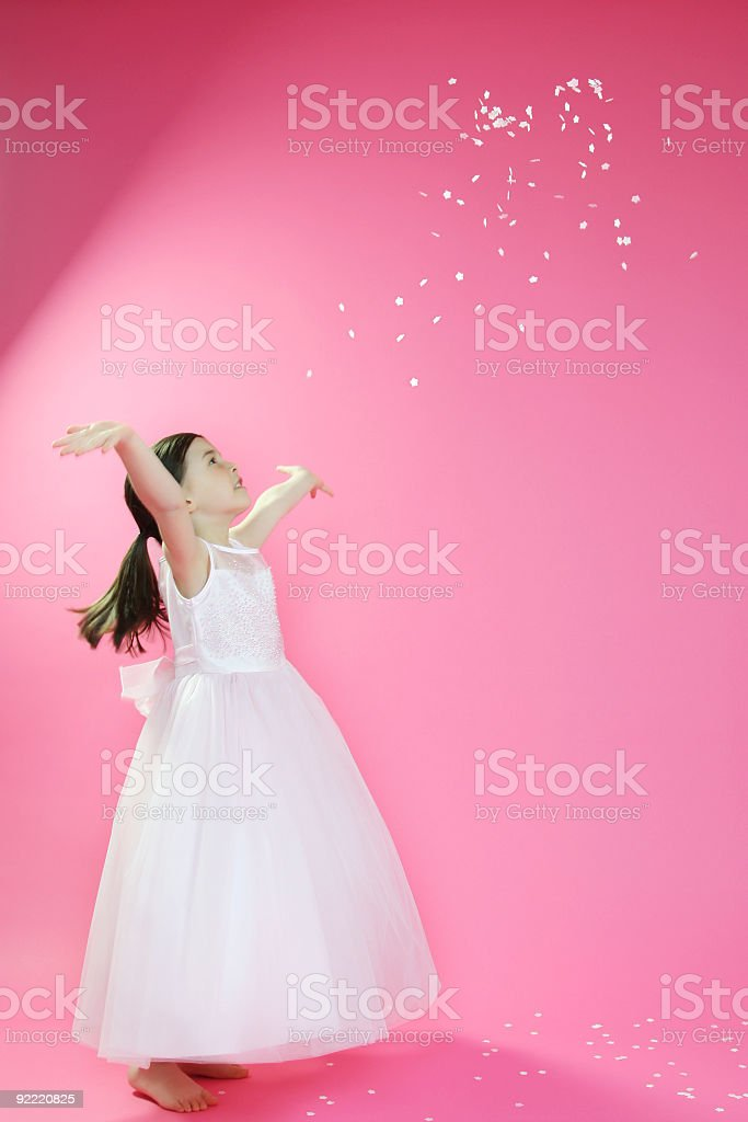 Happy young girl throwing stars stock photo