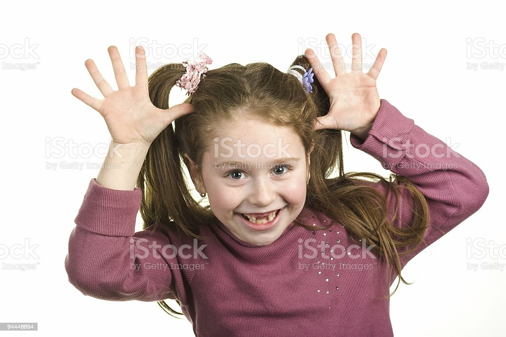 Happy young girl with hands in the air wide open royalty-free stock photo