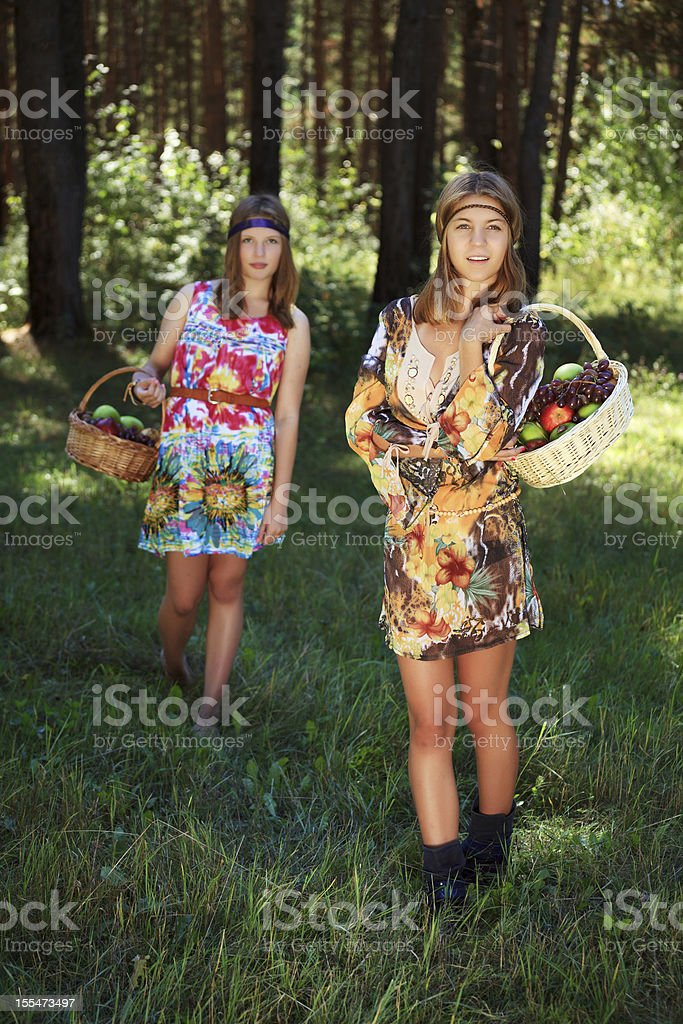 Happy young girls with a fruit basket royalty-free stock photo