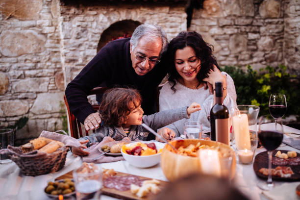 happy young grandson having lunch at grandparents rustic house - spanish food stock photos and pictures