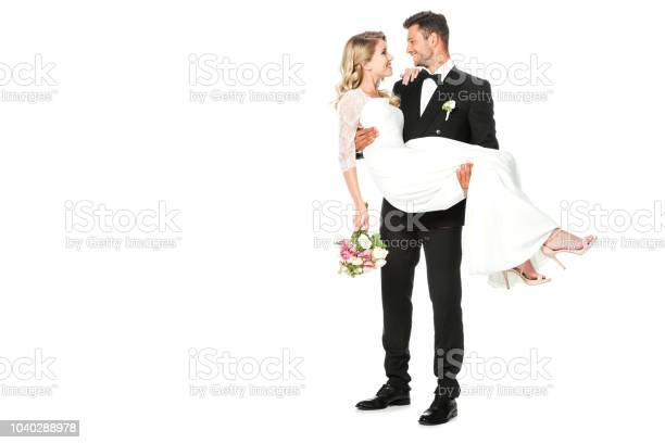 Happy young groom carrying his bride isolated on white picture id1040288978?b=1&k=6&m=1040288978&s=612x612&h=fkfjuc3edqteevrfy8dfqgxuj i q3ukywknftgplty=