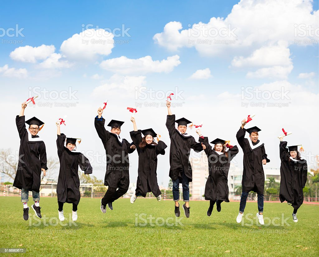 happy young group graduation jumping together stock photo