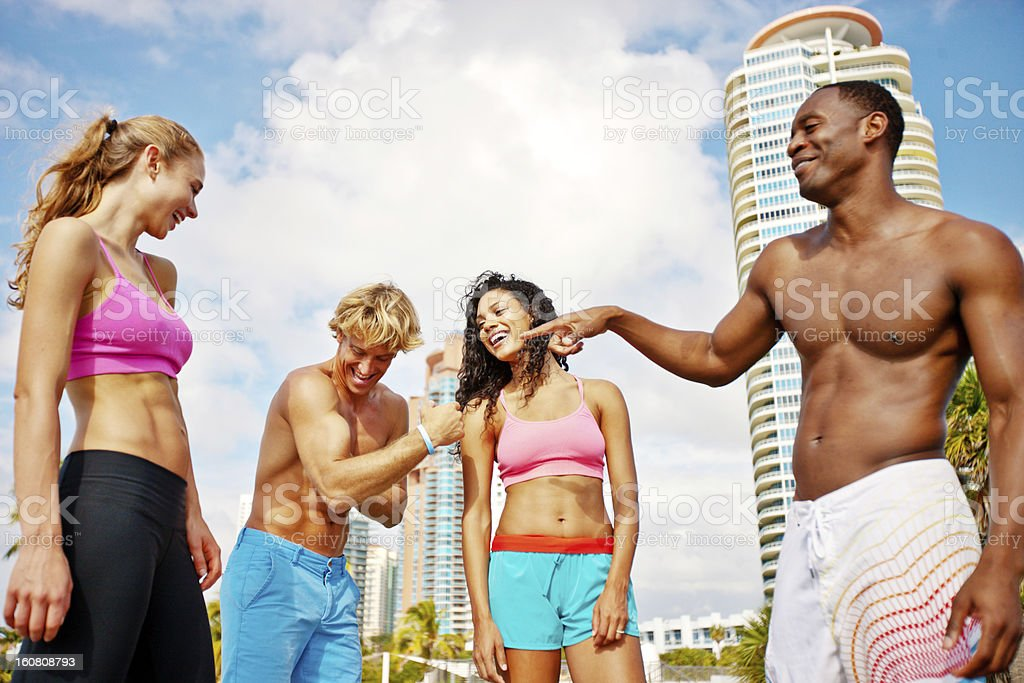 Happy Young Group of Friends Exercising Outdoors royalty-free stock photo