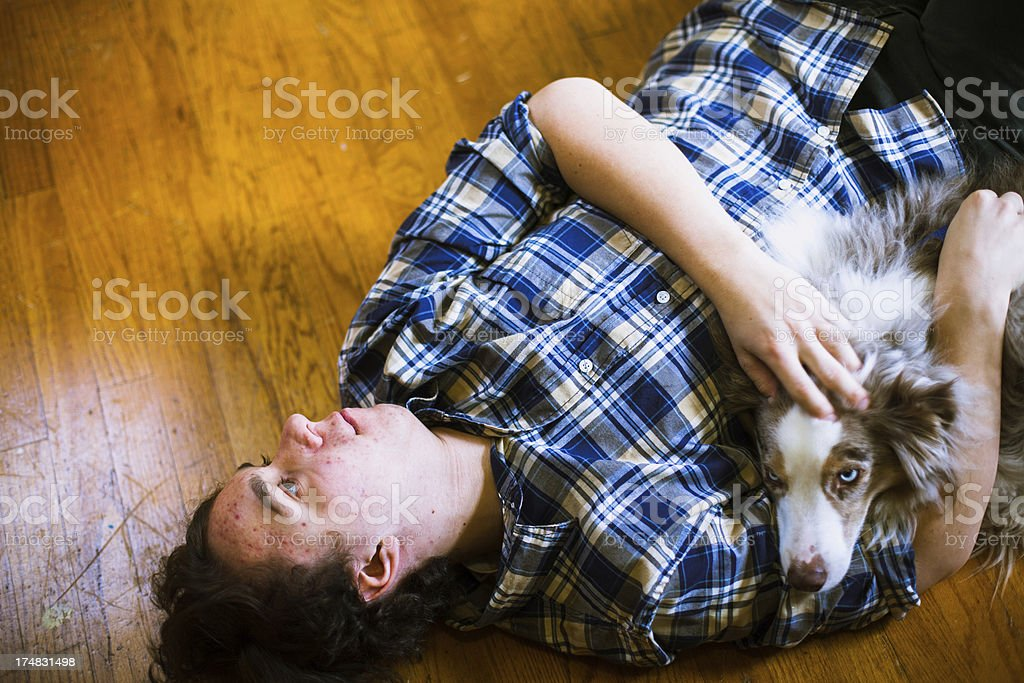 Happy Young Hipster Man Playing with Dog royalty-free stock photo