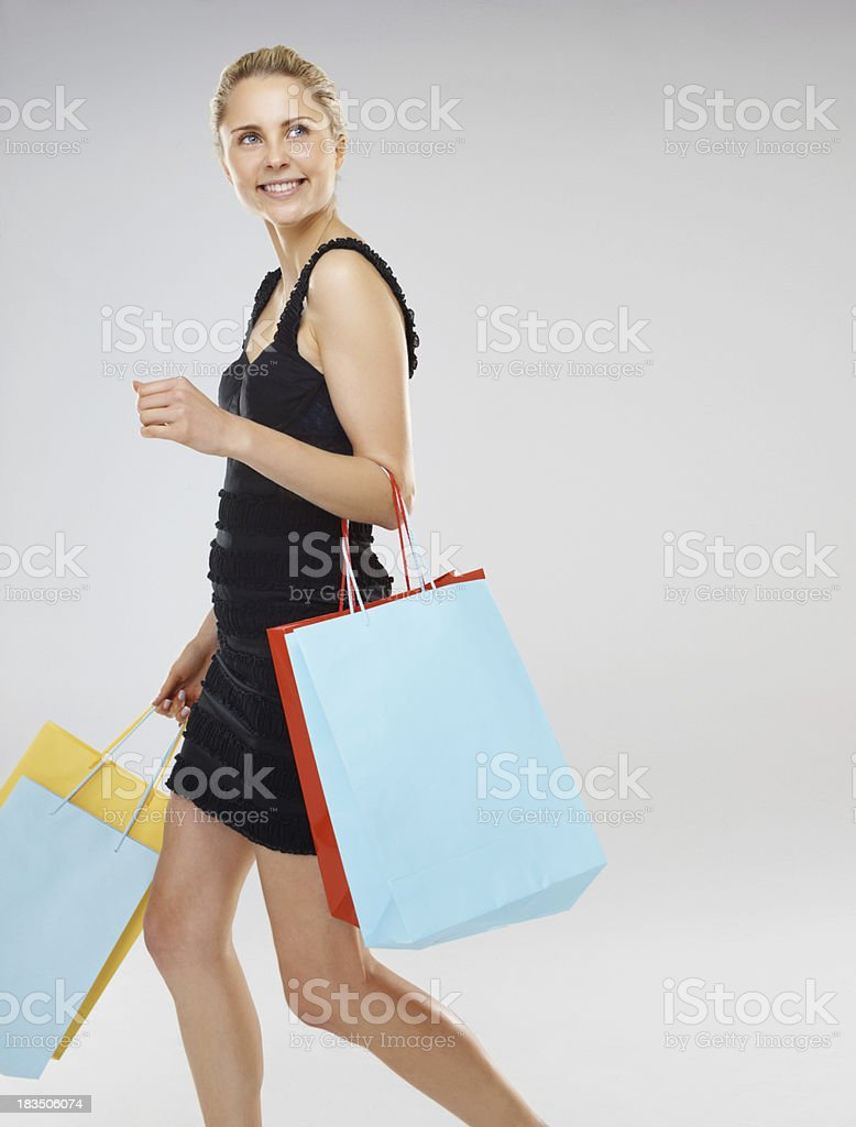 Happy young holding shopping bags royalty-free stock photo