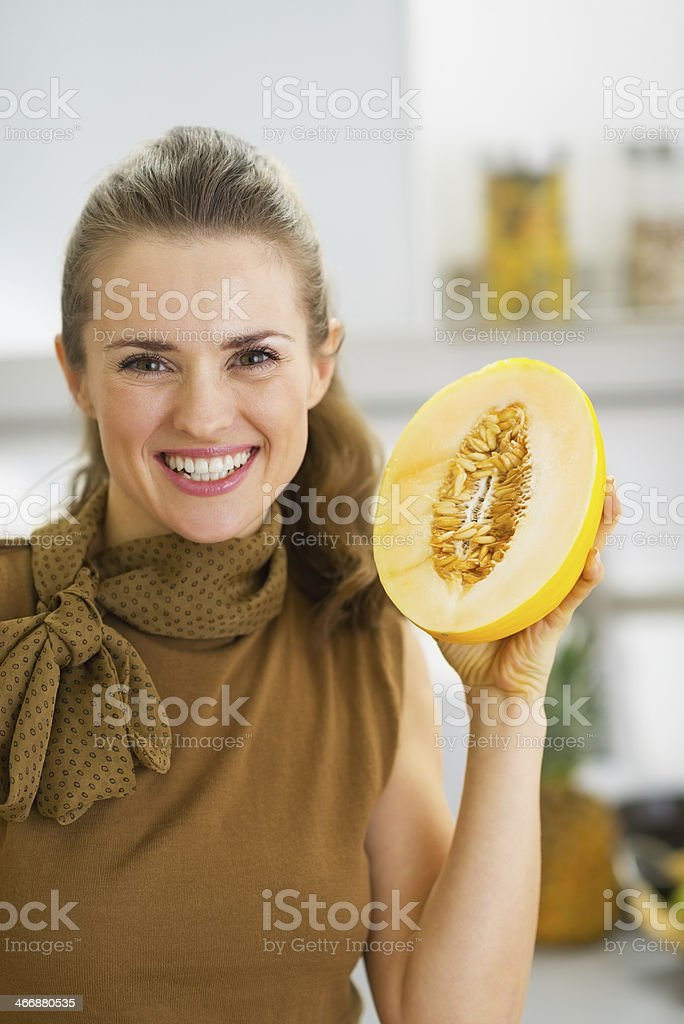 Happy Young Housewife Holding Melon Slice Stock Photo