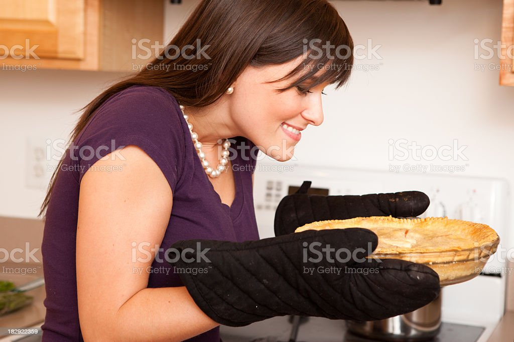 Happy Young Housewife Smelling Freshly Holiday Baked Pie royalty-free stock photo