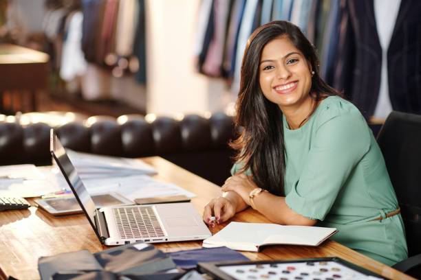 Happy young Indian atelier owner stock photo
