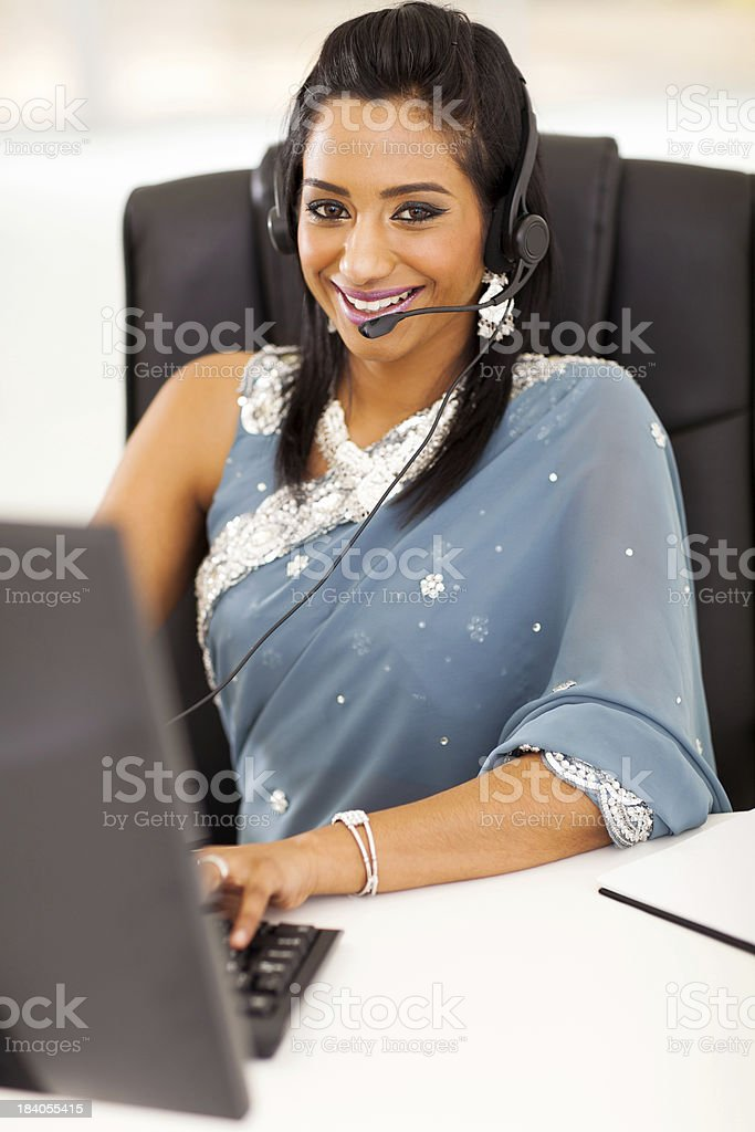 happy young indian call center employee with headset royalty-free stock photo