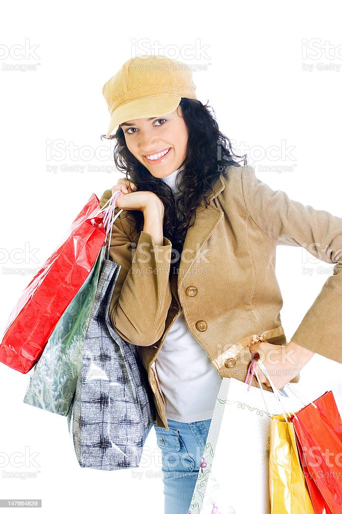 happy young lady holding shopping bags royalty-free stock photo