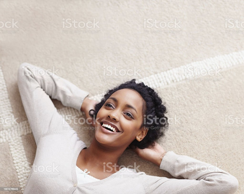 Happy young lady relaxing on the ground royalty-free stock photo