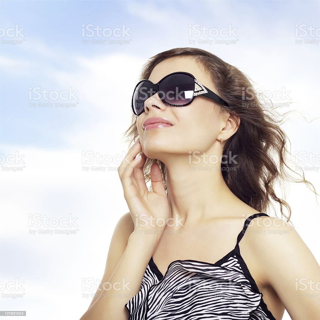 Happy young lady smiling with sunglasses royalty-free stock photo