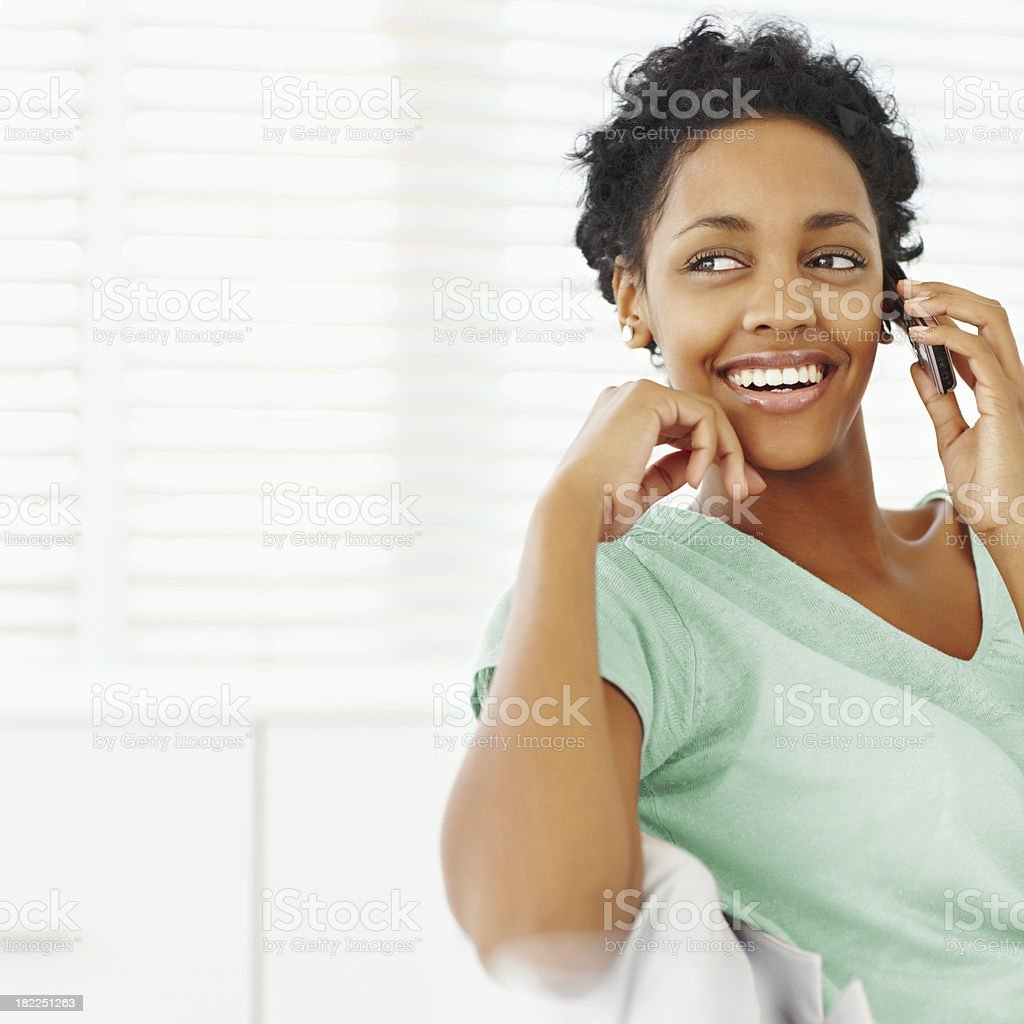 Happy young lady talking on a cellphone royalty-free stock photo