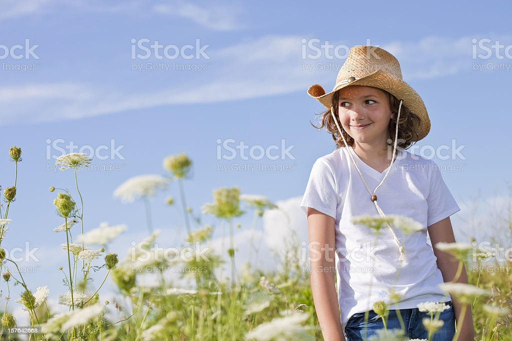 Happy young lady wearing cowboy hat royalty-free stock photo