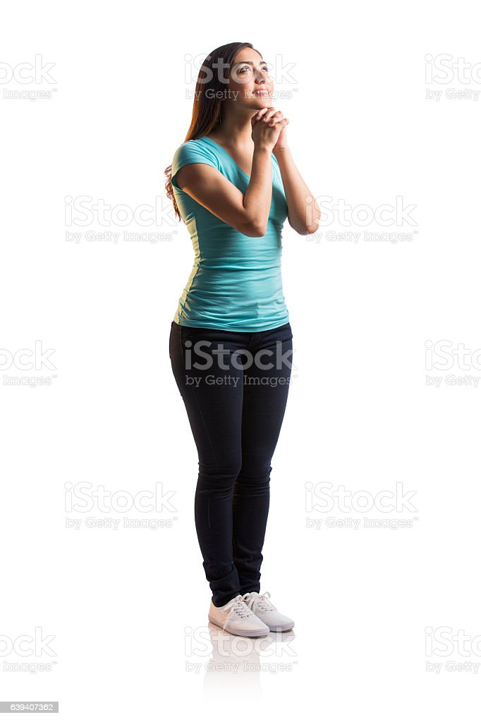 Happy young latin woman standing and praying - foto de stock