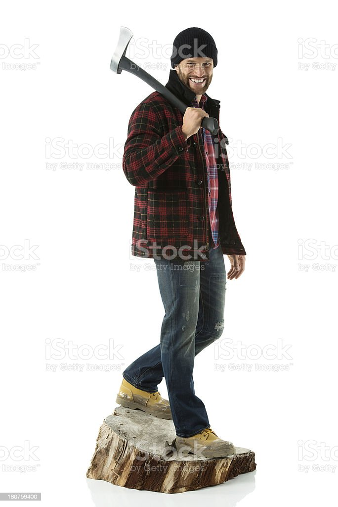 Happy young lumberjack with an axe royalty-free stock photo