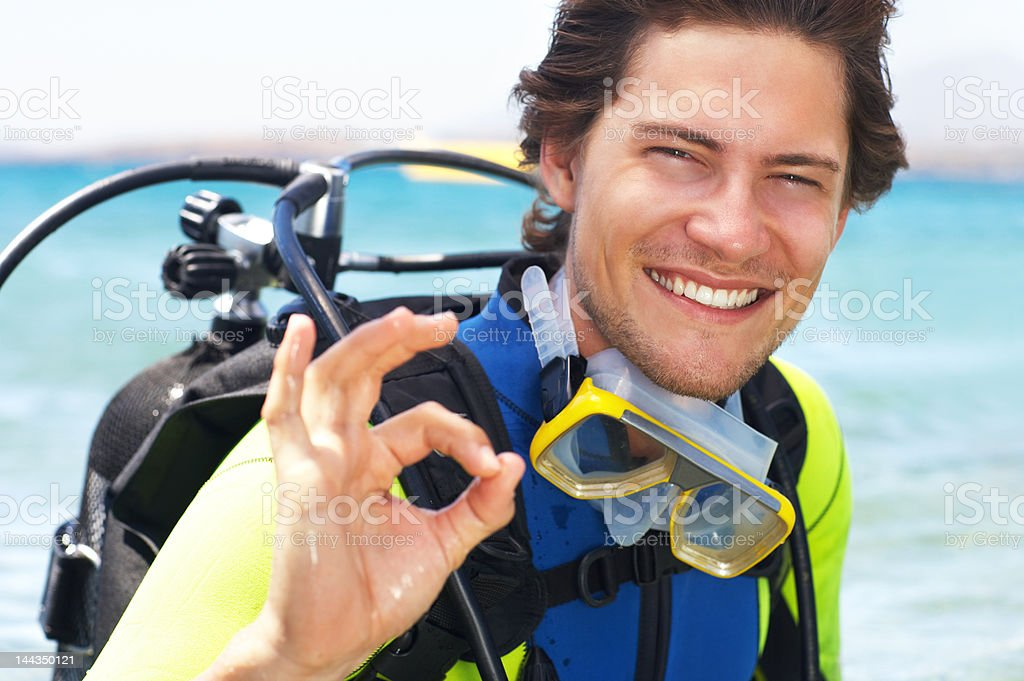Happy young man about to dive royalty-free stock photo