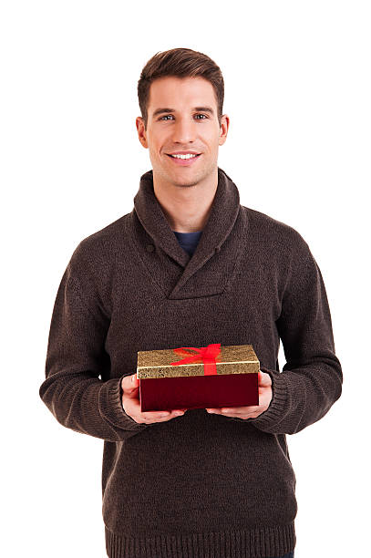 Happy young man carries present stock photo