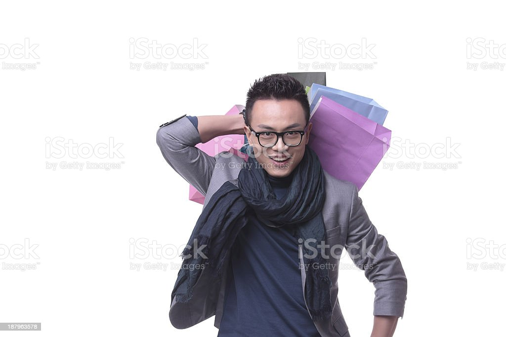 Happy Young Man Carrying Shopping Bag royalty-free stock photo
