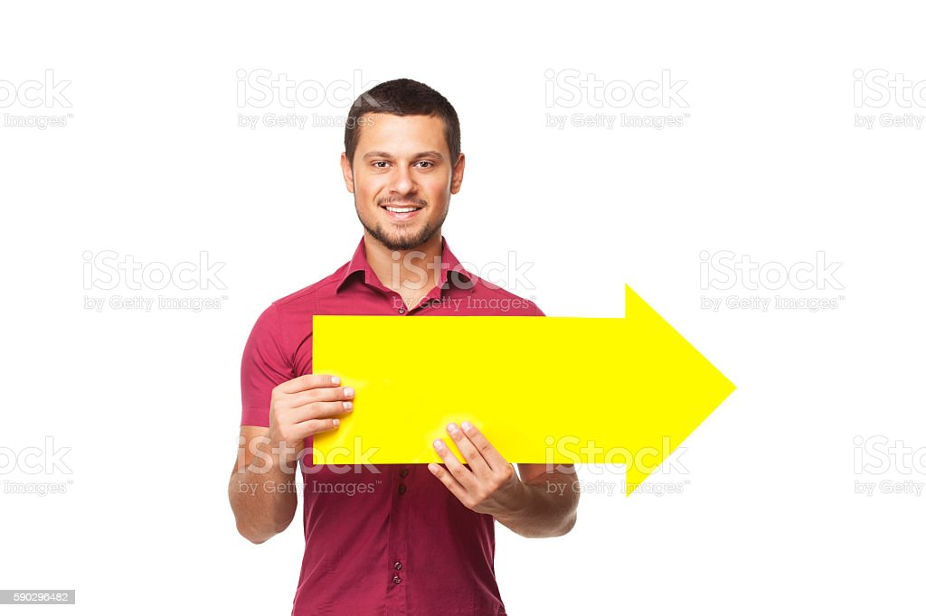 Happy Young  Man Holding Arrow  Sign royaltyfri bildbanksbilder