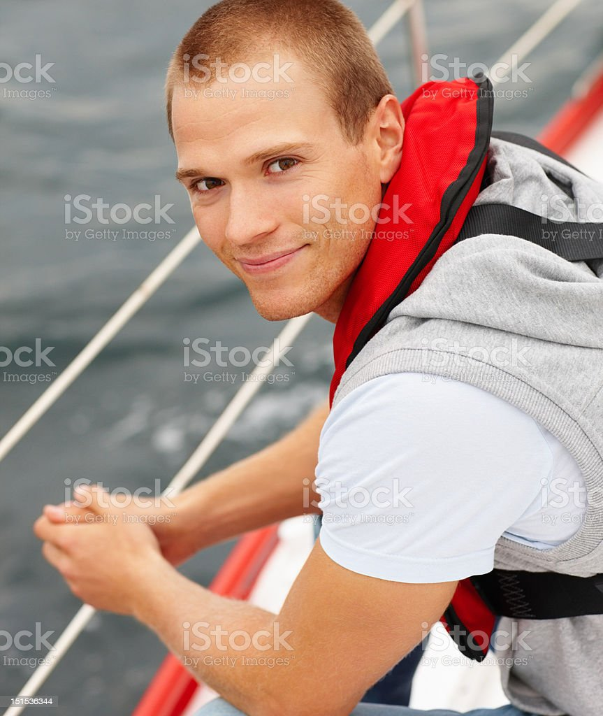 Happy young man in a boat royalty-free stock photo