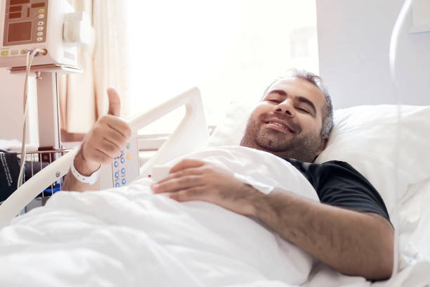 happy young man in the hospital - organ donation stock pictures, royalty-free photos & images