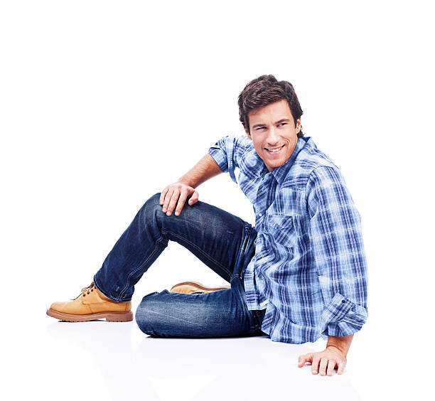 happy young man - sitting on floor stock photos and pictures