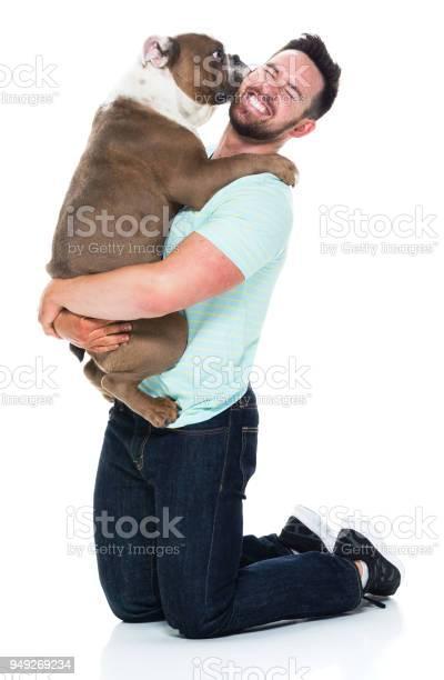 Happy young man playing with his bulldog picture id949269234?b=1&k=6&m=949269234&s=612x612&h=b58gfjwppezmf6zntxq39ptibq1um2pwwfvnh3qeg3a=